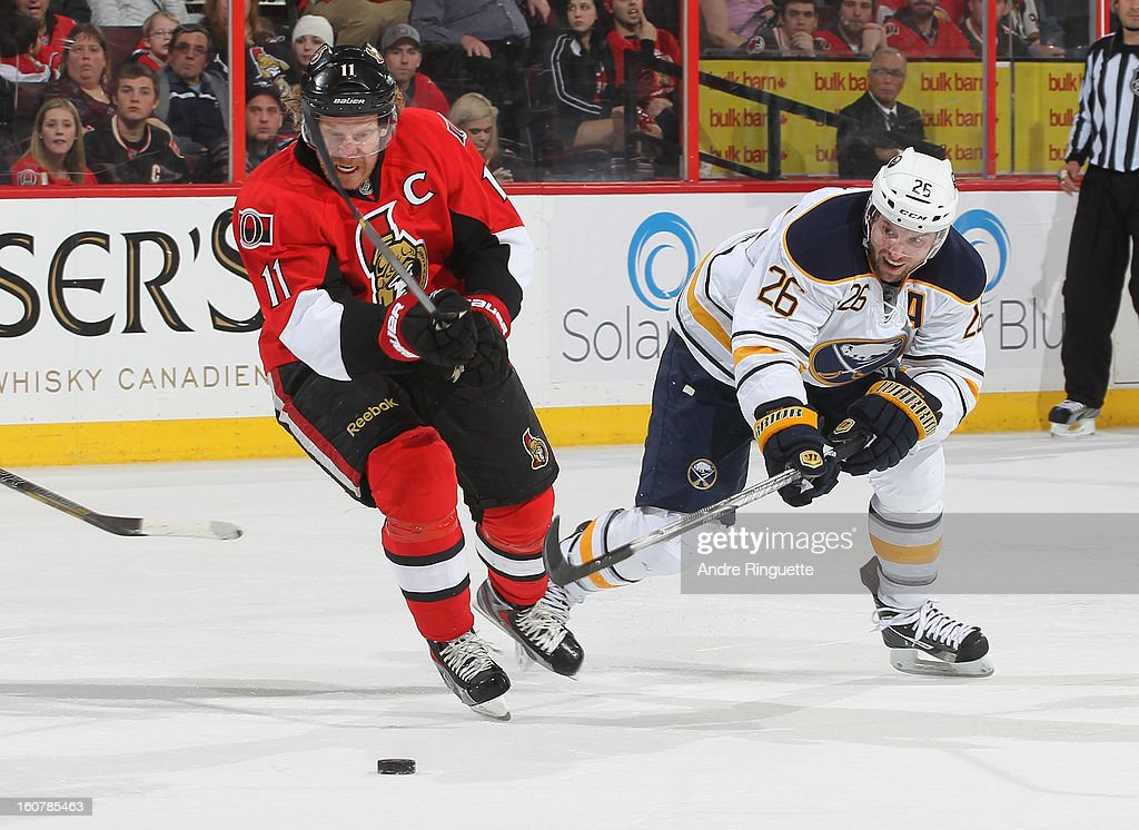 Daniel Alfredsson #11 of the Ottawa Senators stickhandles the puck against Thomas Vanek #26 of the Buffalo Sabres on February 5, 2013 at Scotiabank Place in Ottawa, Ontario, Canada.