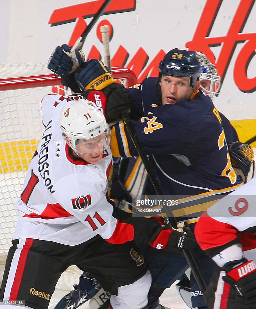 <a gi-track='captionPersonalityLinkClicked' href=/galleries/search?phrase=Daniel+Alfredsson&family=editorial&specificpeople=201853 ng-click='$event.stopPropagation()'>Daniel Alfredsson</a> #11 of the Ottawa Senators works against <a gi-track='captionPersonalityLinkClicked' href=/galleries/search?phrase=Robyn+Regehr&family=editorial&specificpeople=171828 ng-click='$event.stopPropagation()'>Robyn Regehr</a> #24 of the Buffalo Sabres at First Niagara Center on December 31, 2011 in Buffalo, New York. Ottawa won 3-2 in a shootout.