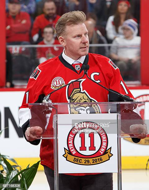 Daniel Alfredsson speaks during his jersey retirement ceremony prior to a game between the Ottawa Senators and the Detroit Red Wings at Canadian Tire...