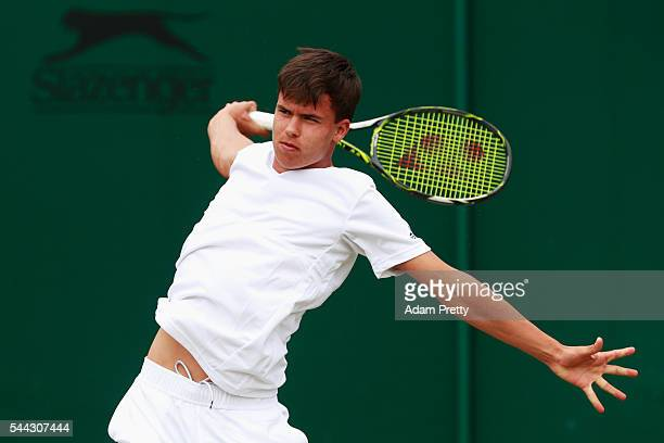Daniel Altmaier of Germany plays a backhand during the Boy's singles first round match against Max Stewart of Great Britain on Middle Sunday of the...