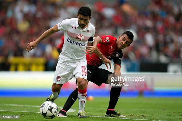 Daniel Alvarez of Atlas fights for the ball with Antonio Naelson of Toluca during the 1st round match between Atlas and Toluca as part of the Torneo...