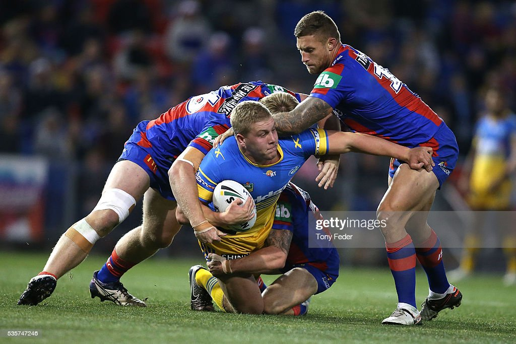 Daniel Alvaro of the Eels is tackled during the round 12 NRL match between the Newcastle Knights and the Parramatta Eels at Hunter Stadium on May 30, 2016 in Newcastle, Australia.