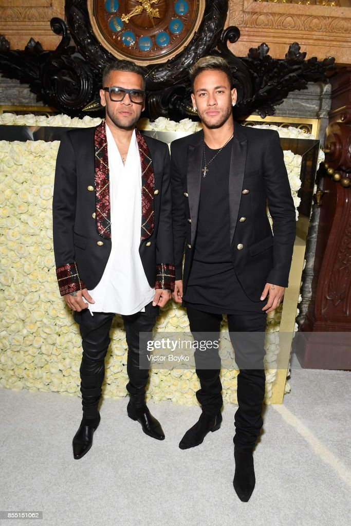 Daniel Alves and Neymar attend the Balmain show as part of the Paris Fashion Week Womenswear Spring/Summer 2018 on September 28, 2017 in Paris, France.