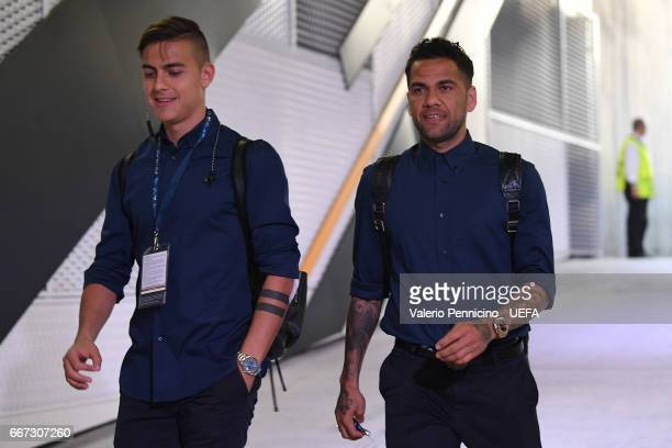 Daniel Alves and Paulo Dybala of Juventus arrive at his dressing room ahead of the the UEFA Champions League Quarter Final first leg match between...