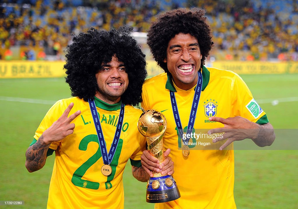 Daniel Alves (L) celebrates with team-mate Dante of Brazil at the end of the FIFA Confederations Cup Brazil 2013 Final match between Brazil and Spain at Maracana on June 30, 2013 in Rio de Janeiro, Brazil.