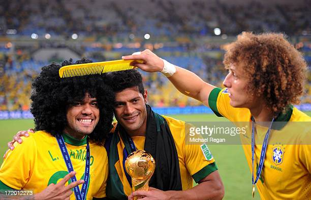 Daniel Alves celebrates with teammates Hulk and David Luiz of Brazil at the end of the FIFA Confederations Cup Brazil 2013 Final match between Brazil...