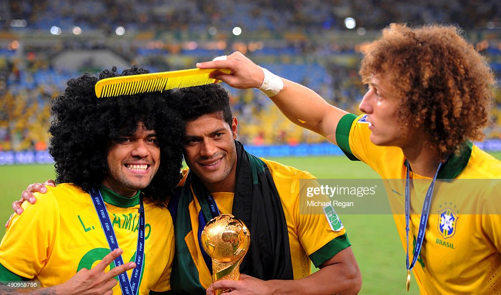 Daniel Alves (L) celebrates with team-mates <a gi-track='captionPersonalityLinkClicked' href=/galleries/search?phrase=Hulk+-+Soccer+Player&family=editorial&specificpeople=7359350 ng-click='$event.stopPropagation()'>Hulk</a> and <a gi-track='captionPersonalityLinkClicked' href=/galleries/search?phrase=David+Luiz&family=editorial&specificpeople=4133397 ng-click='$event.stopPropagation()'>David Luiz</a> of Brazil at the end of the FIFA Confederations Cup Brazil 2013 Final match between Brazil and Spain at Maracana on June 30, 2013 in Rio de Janeiro, Brazil.