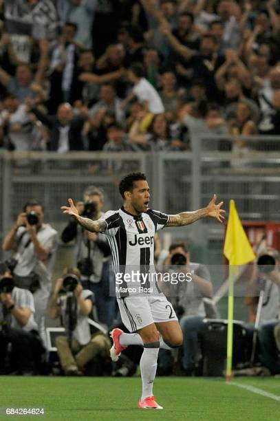 Daniel Alves Da Silva of FC Jucentus celebrates a opening goal during the TIM Cup Final match between SS Lazio and Juventus FC at Olimpico Stadium on...