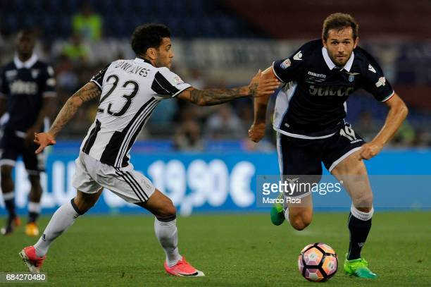 Daniel Alves Da Silva of FC Juventus compete for the ball with Senad Lulic of SS Lazio during the TIM Cup Final match between SS Lazio and Juventus...