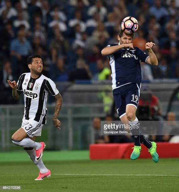 Daniel Alves Da Silva of Juventus FC and Senad Lulic of SS Lazio in action during the TIM Cup Final match between SS Lazio and Juventus FC at...