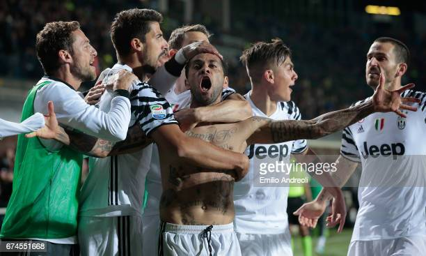 Daniel Alves da Silva of Juventus FC celebrates his goal with his teammates during the Serie A match between Atalanta BC and Juventus FC at Stadio...