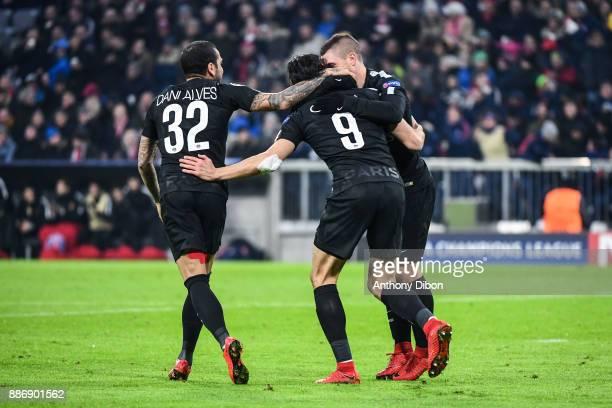 Daniel Alves Edinson Cavani and Marco Verratti of PSG celebrates a goal during the UEFA Champions League match between Bayern Munich and Paris Saint...