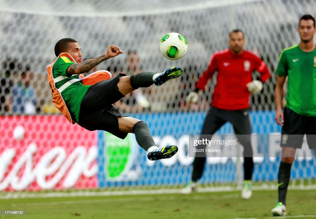 Daniel Alves in action during a Brazil training session ahead of their FIFA Confederations Cup 2013 Semi Final match against Uruguay on June 25, 2013 in Belo Horizonte, Brazil.