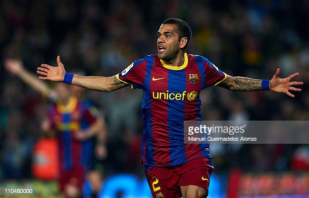 Daniel Alves of Barcelona celebrates after scoring the first goal during the La Liga match between Barcelona and Getafe at Camp Nou on March 19 2011...