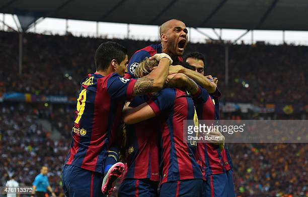 Daniel Alves of Barcelona celebrates with team mates after the goal scored by Ivan Rakitic during the UEFA Champions League Final between Juventus...