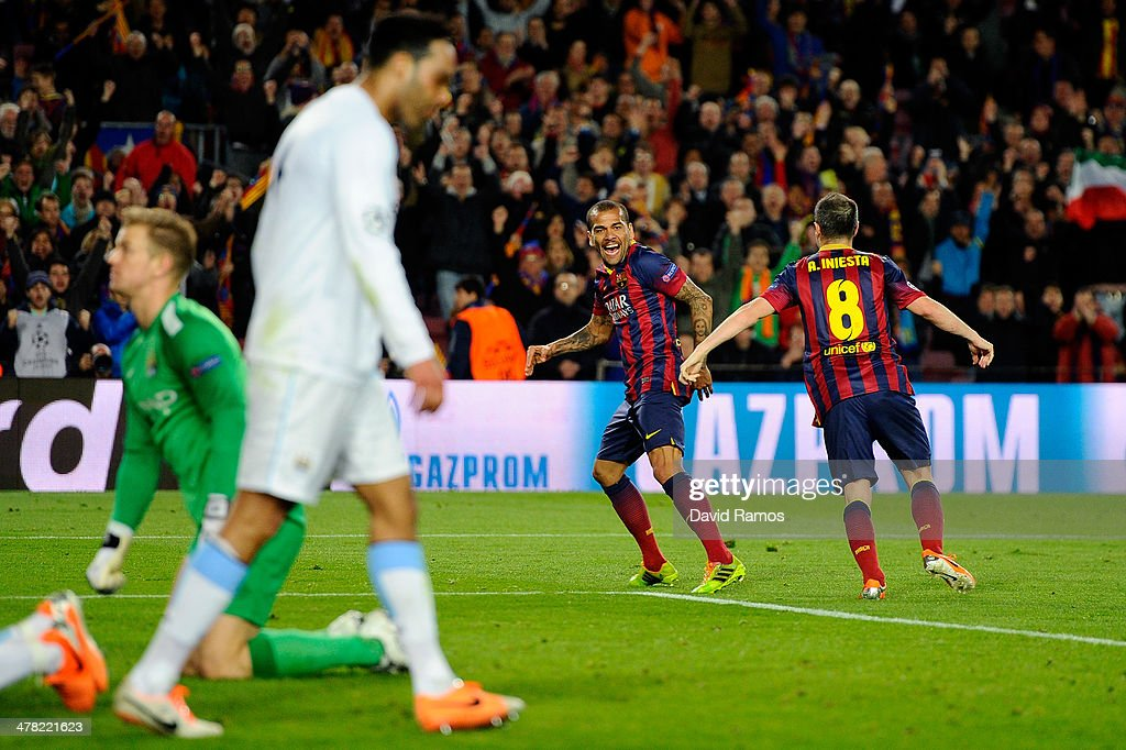 Daniel Alves of Barcelona celebrates with teammate <a gi-track='captionPersonalityLinkClicked' href=/galleries/search?phrase=Andres+Iniesta&family=editorial&specificpeople=465707 ng-click='$event.stopPropagation()'>Andres Iniesta</a> #8 after scoring his team's second goal during the UEFA Champions League Round of 16, second leg match between FC Barcelona and Manchester City at Camp Nou on March 12, 2014 in Barcelona, Spain.