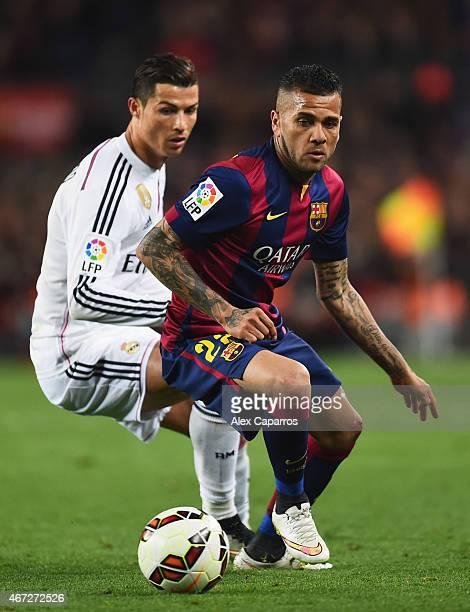Daniel Alves of Barcelona evades Cristiano Ronaldo of Real Madrid CF during the La Liga match between FC Barcelona and Real Madrid CF at Camp Nou on...