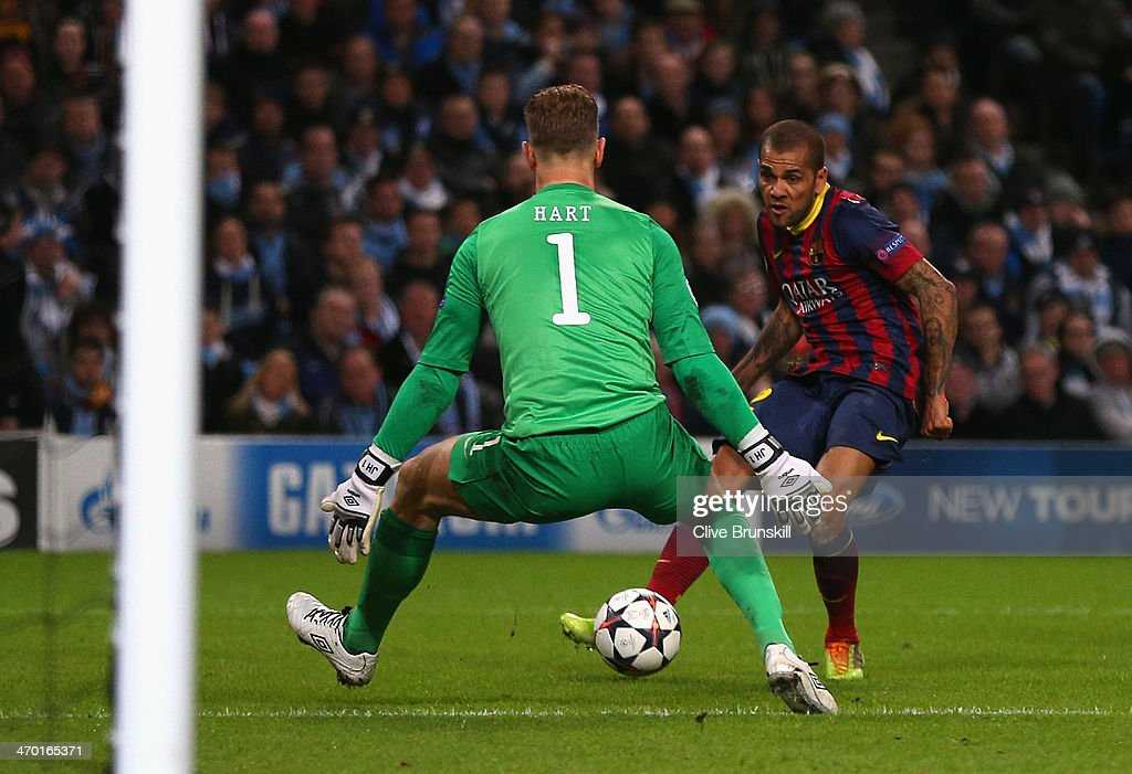 Daniel Alves of Barcelona scores his team's second goal during the UEFA Champions League Round of 16 first leg match between Manchester City and Barcelona at the Etihad Stadium on February 18, 2014 in Manchester, England.