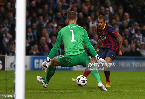 Daniel Alves of Barcelona scores his team's second goal during the UEFA Champions League Round of 16 first leg match between Manchester City and...