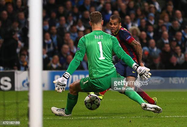 Daniel Alves of Barcelona scores his team's second goal past Joe Hart of Manchester City during the UEFA Champions League Round of 16 first leg match...