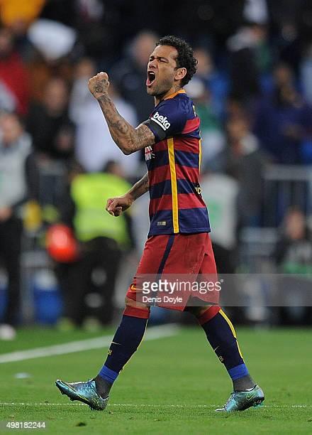 Daniel Alves of FC Barcelona celebrates after his team beat Real Madrid 40 in the La Liga match between at Estadio Santiago Bernabeu on November 21...