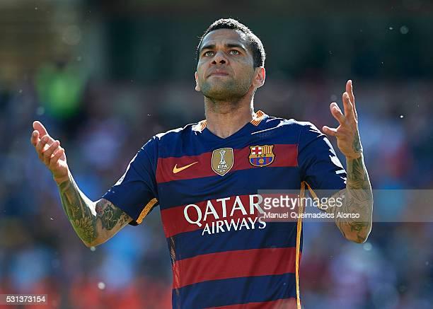 Daniel Alves of FC Barcelona reacts during the La Liga match between Granada CF and FC Barcelona at Estadio Nuevo Los Carmenes on May 14 2016 in...