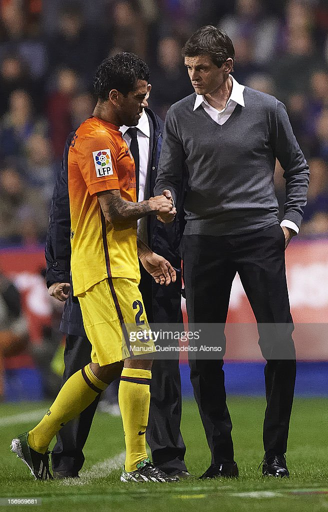 Daniel Alves of FC Barcelona (L) shakes hands with his head coach Tito Vilanova of FC Barcelona during the la Liga match between Levante UD and FC Barcelona at Ciutat de Valencia on November 25, 2012 in Valencia, Spain.