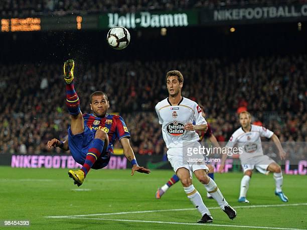 Daniel Alves of FC Barcelona tries to score past Adrian Lopez of Deportivo la Coruna during the La Liga match between Barcelona and Deportivo La...