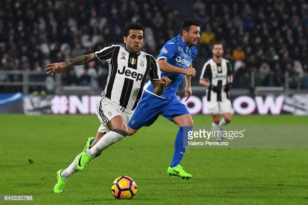 Daniel Alves of Juventus FC runs of Manuel Pasqual of Empoli FC during the Serie A match between Juventus FC and Empoli FC at Juventus Stadium on...