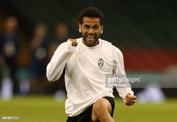 Daniel Alves of Juventus reacts during a training session prior to The UEFA Champions League Final between Juventus and Real Madrid at the National...