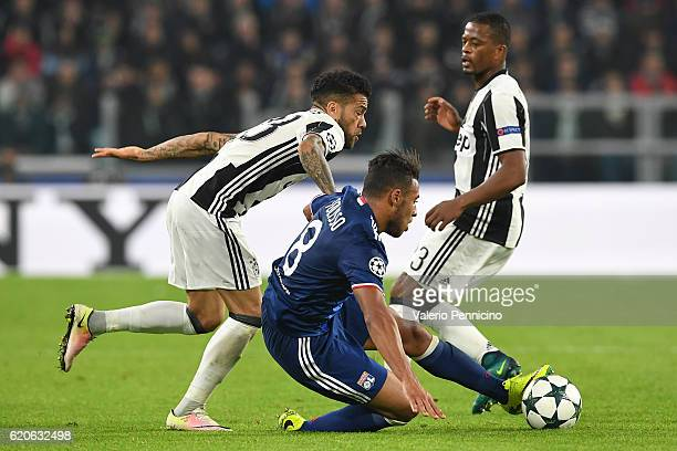 Daniel Alves of Juventus tackles Corentin Tolisso of Olympique Lyonnais during the UEFA Champions League Group H match between Juventus and Olympique...