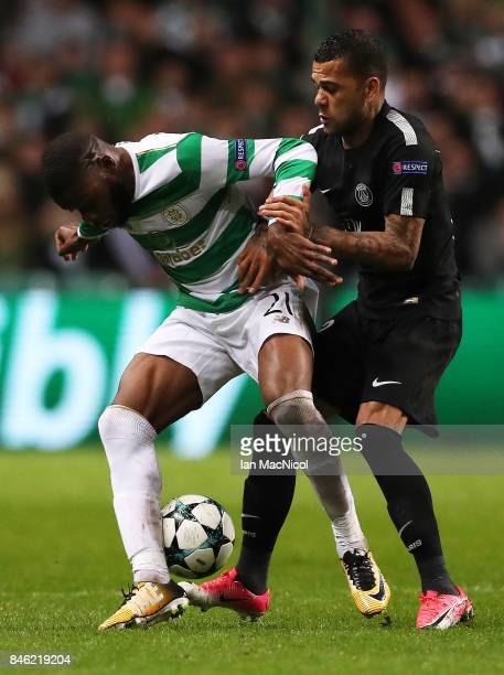 Daniel Alves of Paris SaintGermain vies with Olivier Ntcham of Celtic during the UEFA Champions League Group B match Between Celtic and Paris...