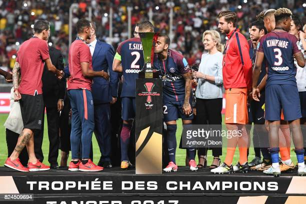 Daniel Alves of PSG kisses the trophy during the Champions Trophy match between Monaco and Paris Saint Germain at Stade IbnBatouta on July 29 2017 in...