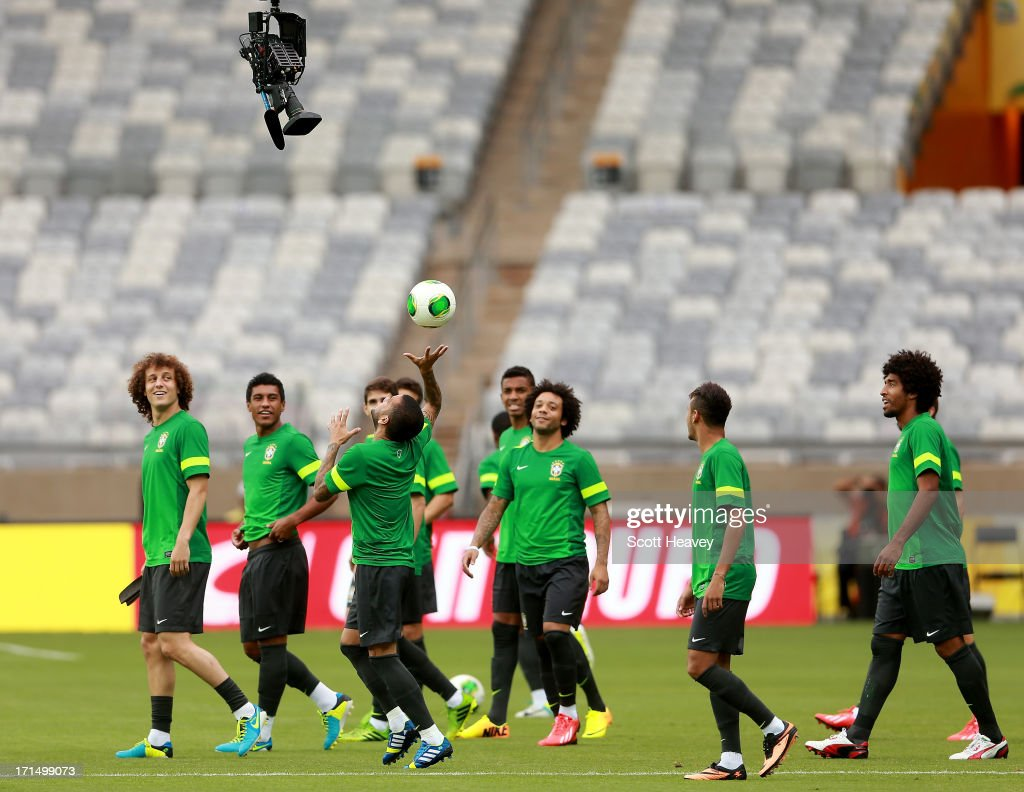Daniel Alves throws a ball at the spider cam during a Brazil training session ahead of their FIFA Confederations Cup 2013 Semi Final match against Uruguay on June 25, 2013 in Belo Horizonte, Brazil.