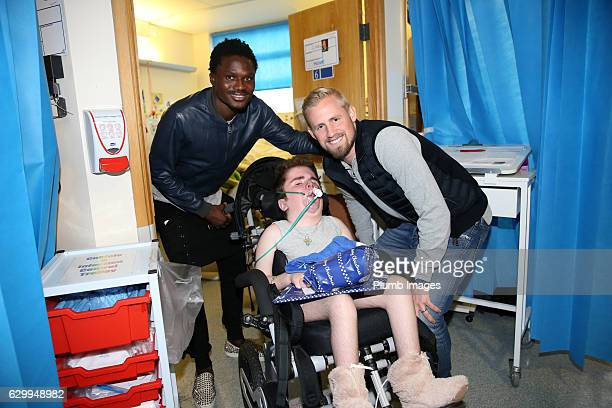 Daniel Amartey and Kasper Schmeichel during the Leicester City Players Deliver Christmas Presents to Patients at Leicester Royal Infirmary on...