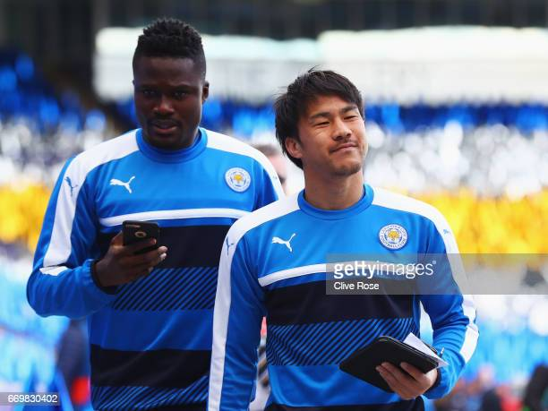 Daniel Amartey and Shinji Okazaki of Leicester City arrive prior to the UEFA Champions League Quarter Final second leg match between Leicester City...