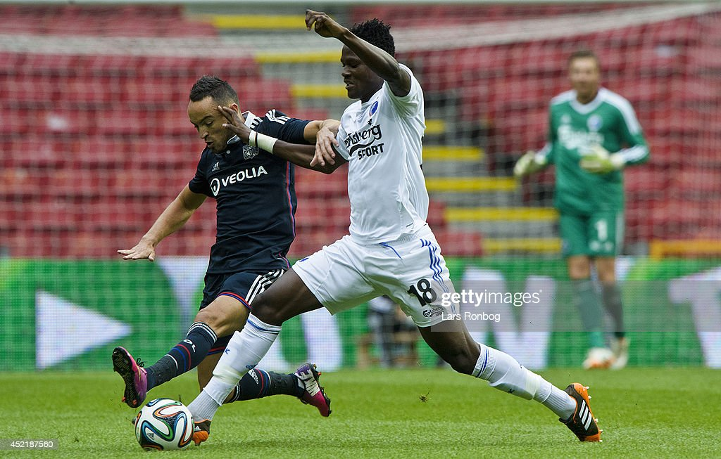 <a gi-track='captionPersonalityLinkClicked' href=/galleries/search?phrase=Daniel+Amartey&family=editorial&specificpeople=12946947 ng-click='$event.stopPropagation()'>Daniel Amartey</a> of FC Copenhagen and <a gi-track='captionPersonalityLinkClicked' href=/galleries/search?phrase=Gael+Danic&family=editorial&specificpeople=650403 ng-click='$event.stopPropagation()'>Gael Danic</a> of Olympique Lyonnais compete for the ball during the Pre-Season Friendly match between FC Copenhagen and Olympique Lyonnais in Parken Stadium on July 15, 2014 in Copenhagen, Denmark.