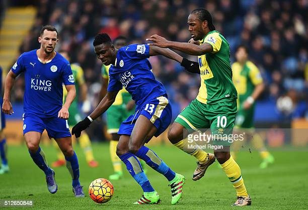 Daniel Amartey of Leicester City and Cameron Jerome of Norwich City compete for the ball during the Barclays Premier League match between Leicester...