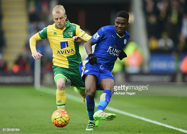 Daniel Amartey of Leicester City and Steven Naismith of Norwich City compete for the ball during the Barclays Premier League match between Leicester...