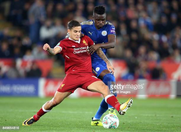Daniel Amartey of Leicester City challenges Philippe Coutinho of Liverpool during the Carabao Cup third round match between Leicester City and...