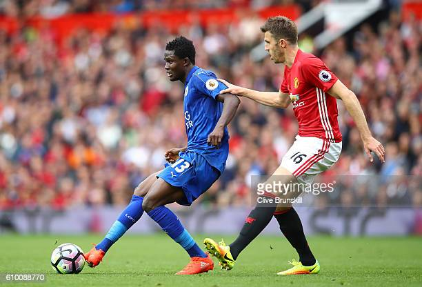 Daniel Amartey of Leicester City passes the ball while under pressure from Michael Carrick of Manchester United during the Premier League match...