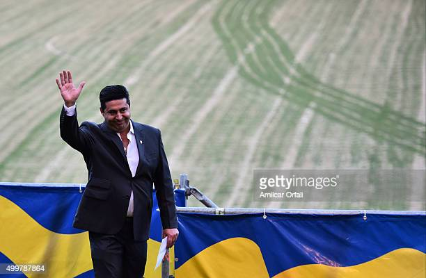 Daniel Angelici President of Boca Juniors enters to the field during a ceremony to honor newly elected President of Argentina Mauricio Macri for his...