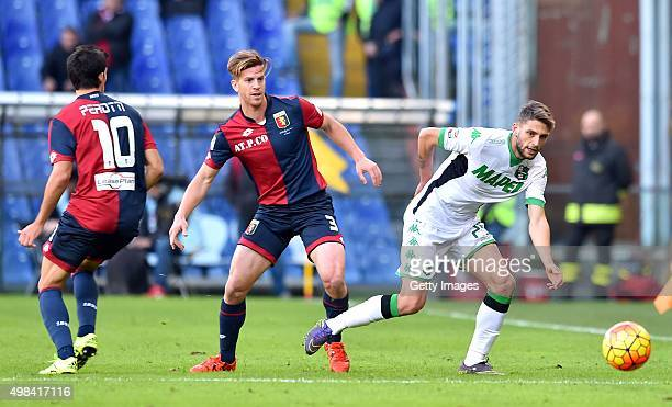 Daniel Ansaldi of Genoa CFC fights for the ball with Domenico Berardi of Sassuolo during the Serie A match between Genoa CFC and US Sassuolo Calcio...