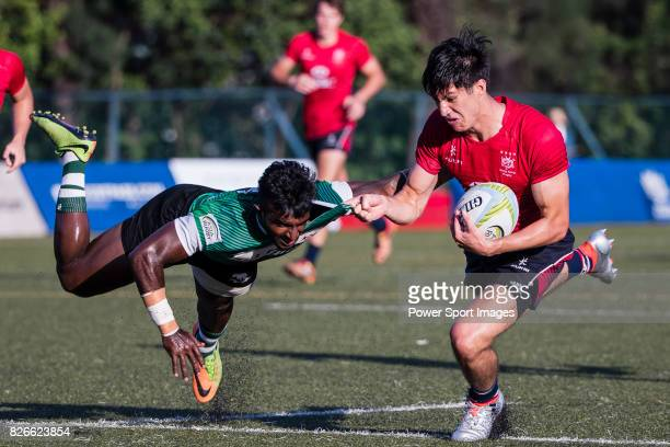 Daniel Archer of Hong Kong is tackled by Lahiru Herath Mudiyanselage of Sri Lanka during the Asia Rugby U20 Sevens 2017 at King's Park Sports Ground...
