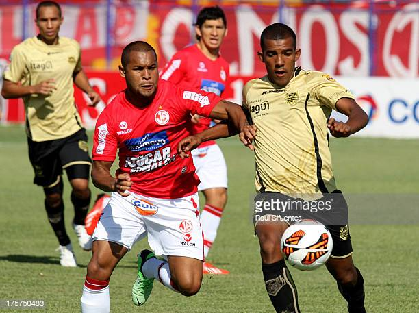 Daniel Arismendi of Juan Aurich fights for the ball with Fabio Rodriguez of Itagui during a match between Juan Aurich and Itagui as part of The Copa...
