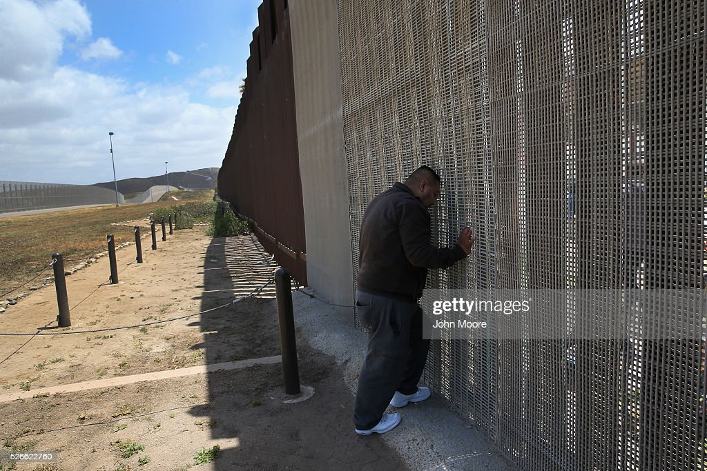 Daniel Armendarec speaks with his wife and children through the U.S.-Mexico border fence on April 30, 2016 in San Diego, California. Five families, with some members living in Mexico and others in the United States, were permitted to meet and embrace for three minutes each at a door in the fence, which the U.S. Border Patrol opened to celebrate Mexican Children's Day. It was only the third time the fence, which separates San Diego from Tijuana, had been opened for families to briefly reunite. The event was planned by the immigrant advocacy group Border Angels.