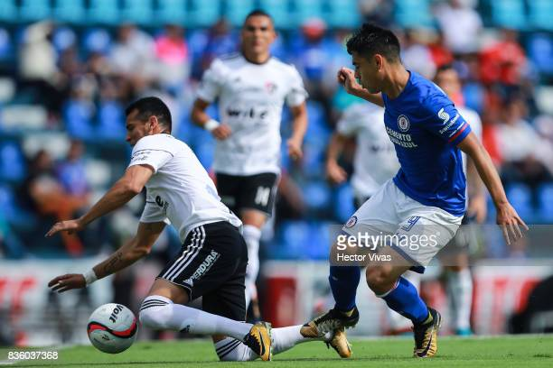 Daniel Arreola of Atlas struggles for the ball with Felipe Mora of Cruz Azul during the fifth round match between Cruz Azul and Atlas as part of the...