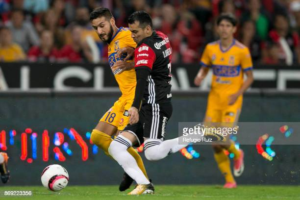 Daniel Arreola of Atlas tries tokick the ball as Ismael Sosa of Tigres defends during the 8th round match between Atlas and Tigres UANL as part of...