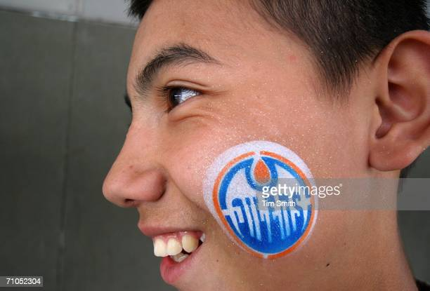 Daniel Atienza a fan of the Edmonton Oilers with the Oilers logo painted on his cheek shows his support prior to the 2006 NHL Playoff game four of...