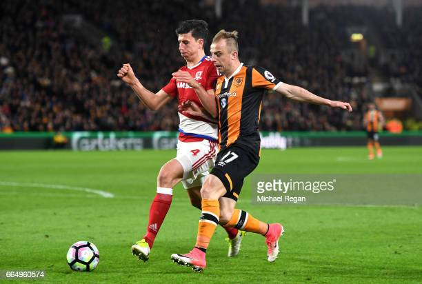 Daniel Ayala of Middlesbrough and Kamil Grosicki of Hull City battle for possession during the Premier League match between Hull City and...